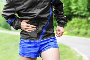 Man runner side cramps after running outdoors